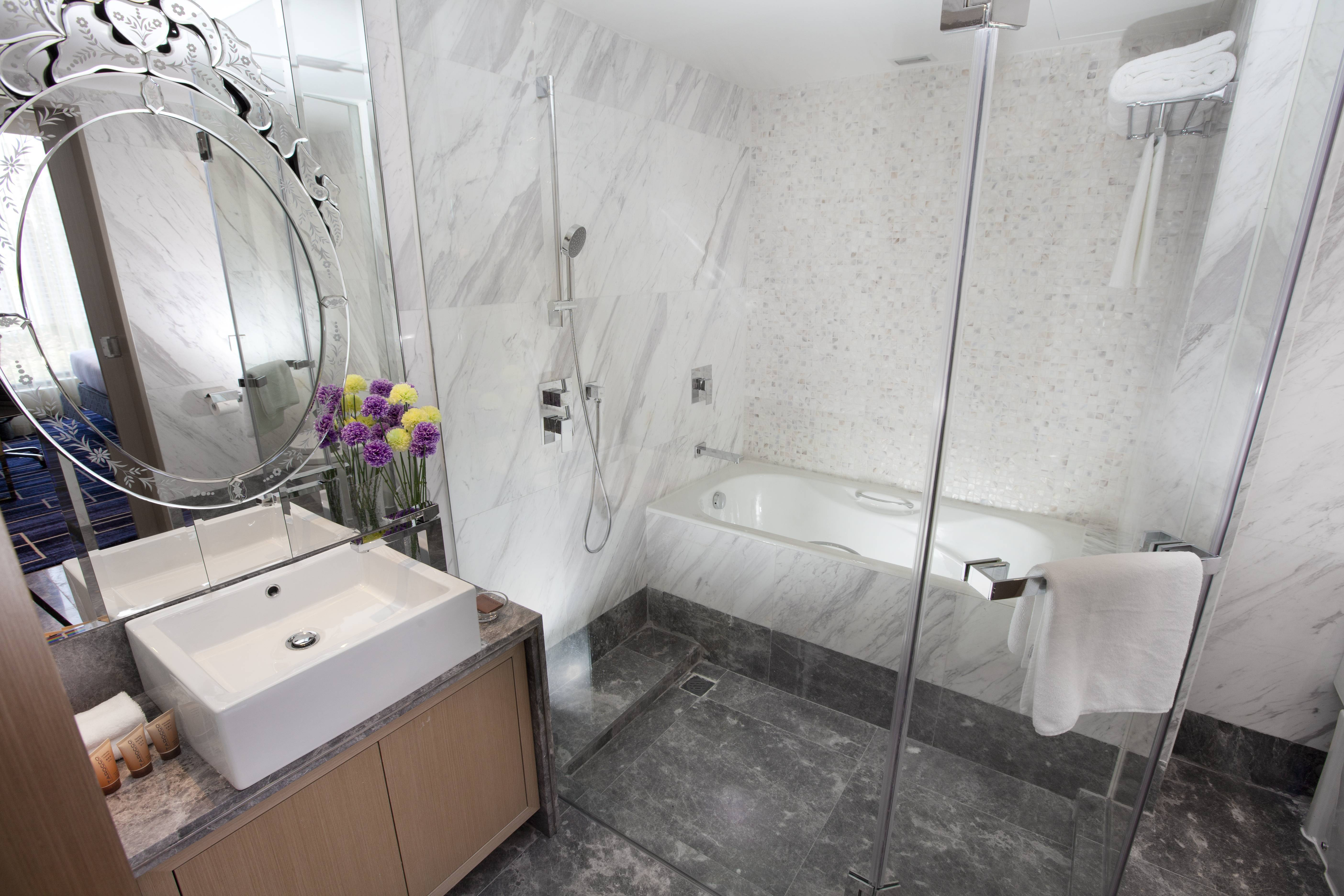 Executive Suite with Sofa Bed Bathroom Modern bathtub or rain shower to relax with quality toiletries