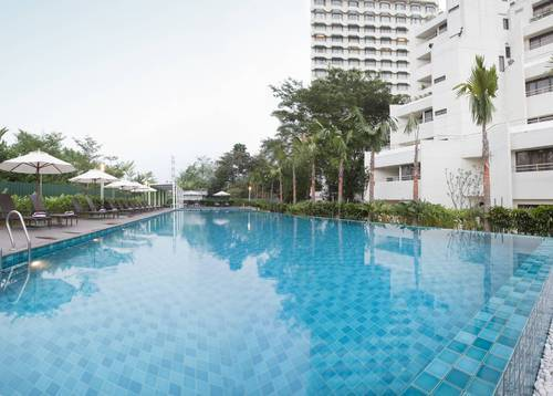 The outdoor sparkling pool, offering an inviting respite from the day's heat