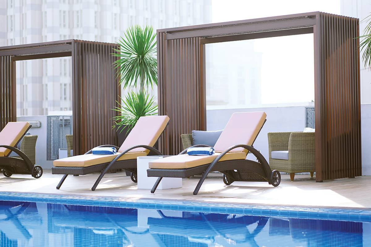 Try our luxurious rooftop infinity swimming pool (cabana seating area)